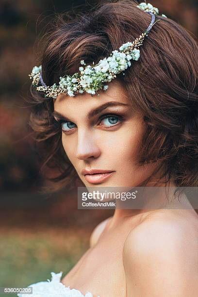 Beautiful bride on a background of autumn forest