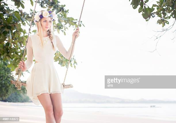 Beautiful Bride on a Swing by the Ocean