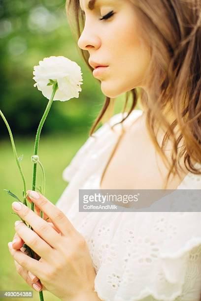 Beautiful bride smelling flower