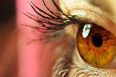 a shallow depth macro image of an eye focused on the iris.