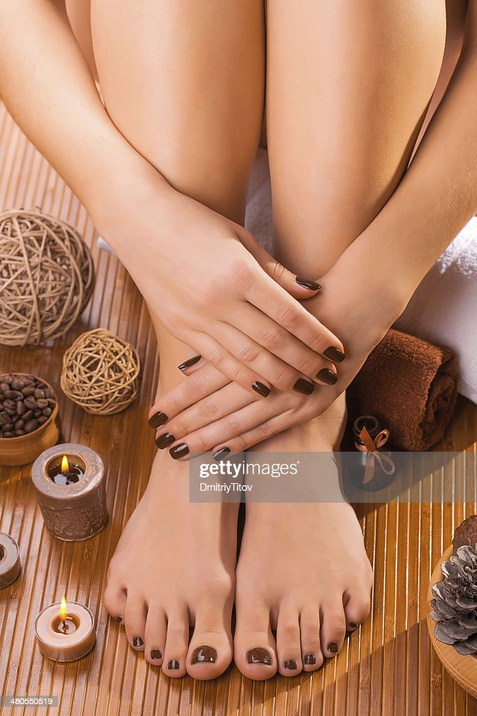beautiful brown manicure and pedicure : Stock Photo