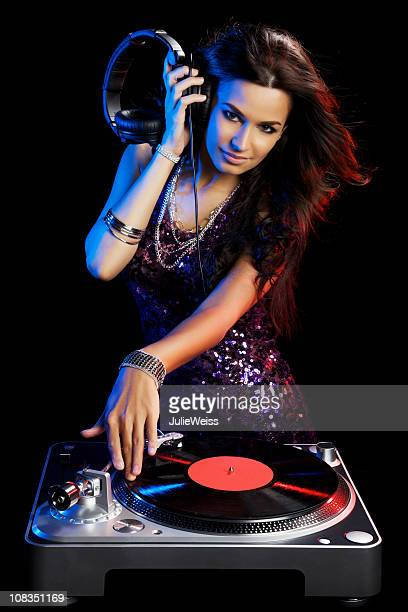 Beautiful Brunette DJ With a Turntable