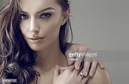 Beautiful brunette engaged female wearing a ring