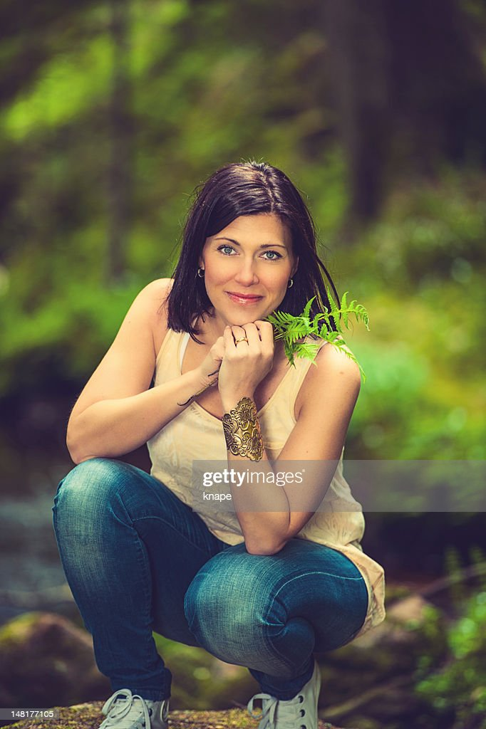 Beautiful brunette enjoying nature : Stock Photo