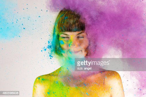 beautiful brunette girl in colors Holi on a white : Stock Photo