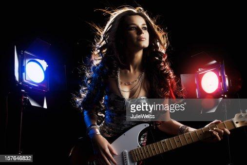 Beautiful Brunette Guitar Player