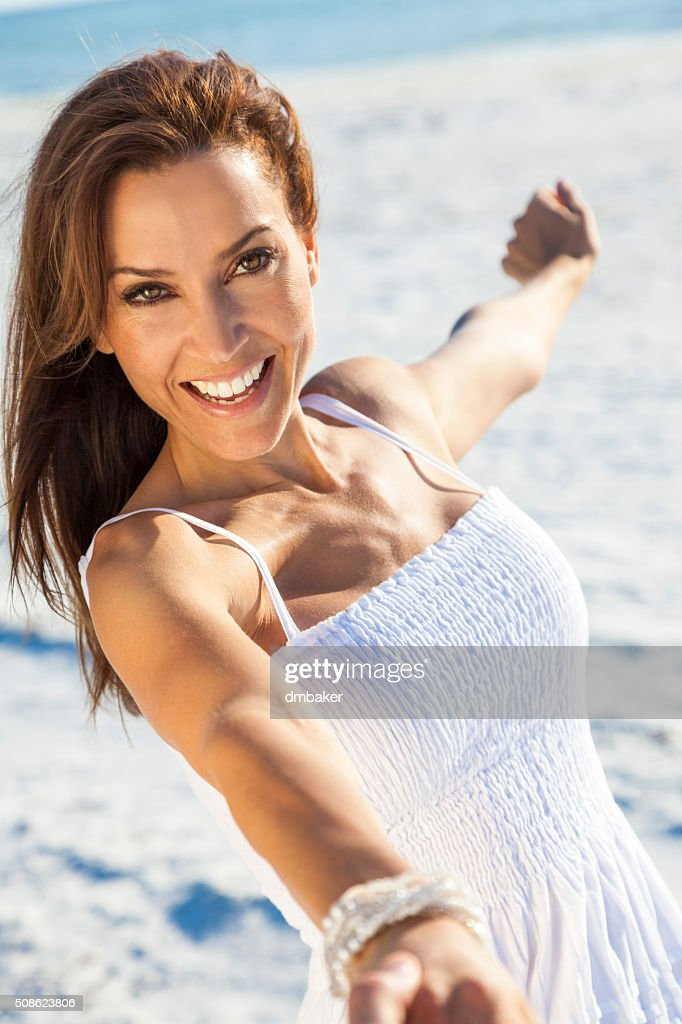 Beautiful Brunette Woman Laughing On A Beach : Stock Photo