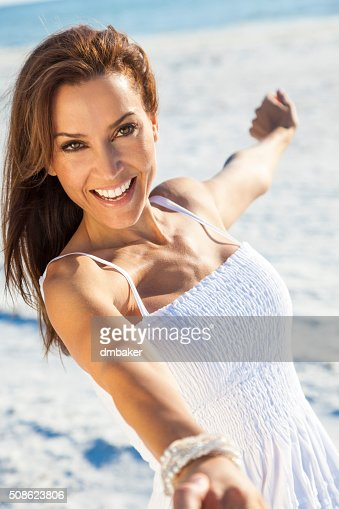 Beautiful Brunette Woman Laughing On A Beach : Stock Photo