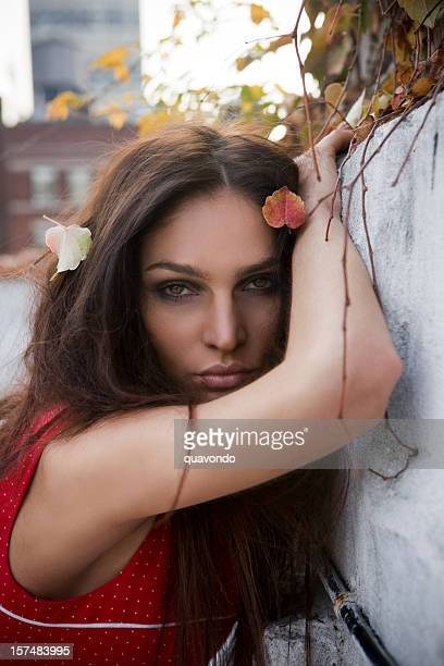 Beautiful Brunette Young Woman Fashion Model on Rooftop in Fall