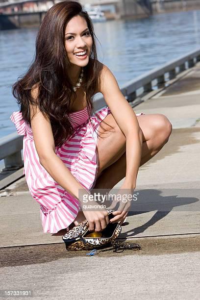 Beautiful Brunette Young Woman Fashion Model Picking Up Purse Outside