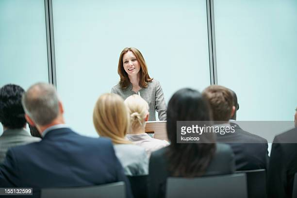 Beautiful business woman presenting during a conference