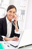 Beautiful business woman working in office