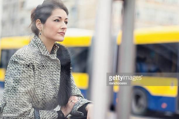 Beautiful businesswoman at bus stop