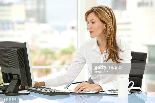 Beautiful businesswoman at workplace