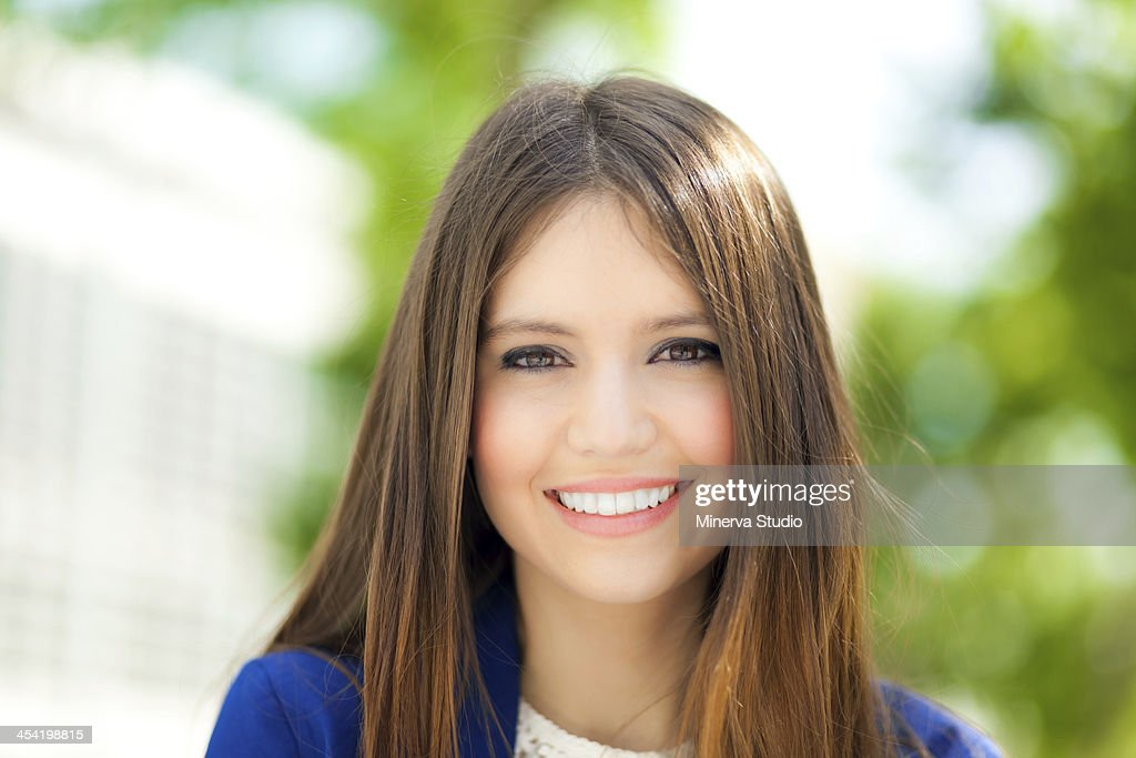 Beautiful businesswoman in urban setting : Stock Photo