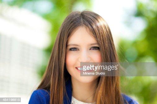 Beautiful businesswoman in urban setting : Stock Photo