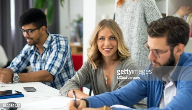 Beautiful businesswoman lookig at camera