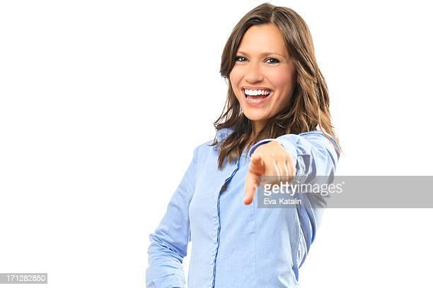 Beautiful businesswoman pointing towards camera