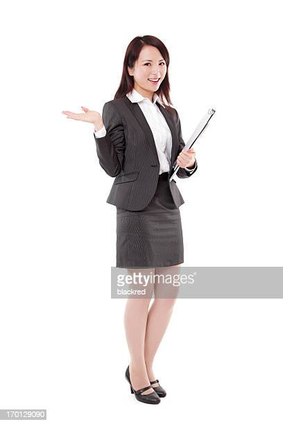 Beautiful Businesswoman Presenting with Clipboard Smiling on White Background