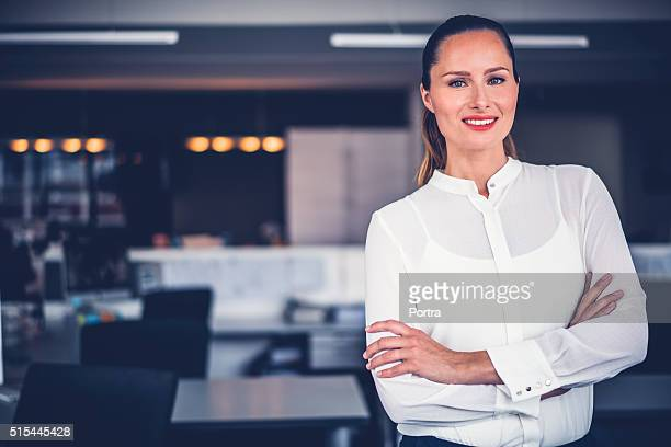 Beautiful businesswoman standing arms crossed