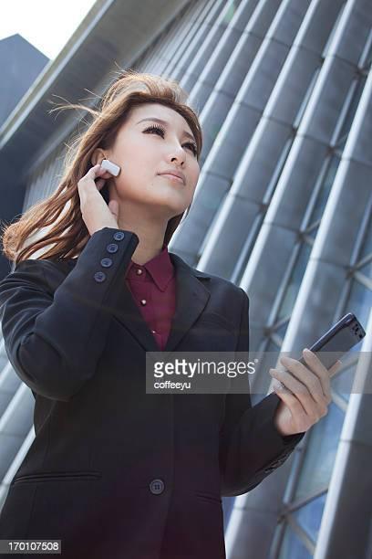 Beautiful businesswomen making phone call