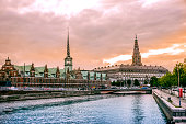 Beautiful Canal in Copenhagen and view of Stock Exchange Building at Sunset