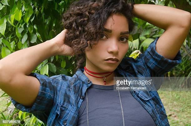 Beautiful caribbean woman in the field