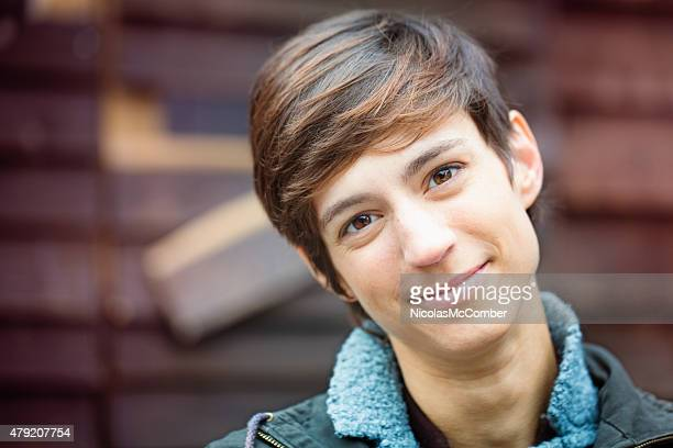 Beautiful cheerful young androgynous British woman kind smile