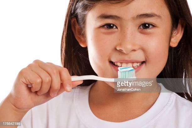 Beautiful Child Brushing Teeth