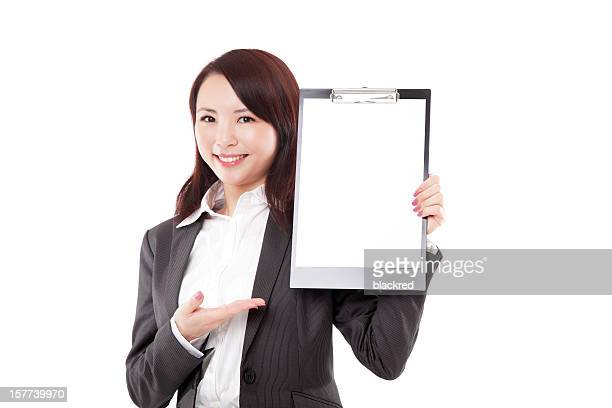 Beautiful Chinese Businesswoman Presenting with Clipboard on White Background