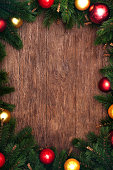 Beautiful christmas background. Fir branches, red and yellow evening balls and golden stars.
