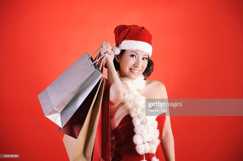 Beautiful Christmas Girl Holding Shopping Bags : Stock Photo