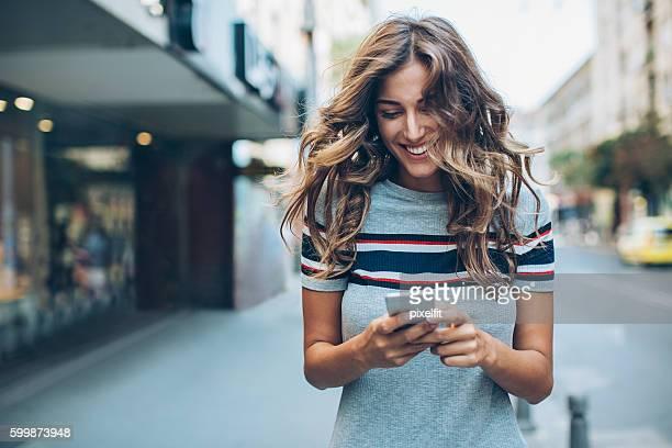 Beautiful city girl texting