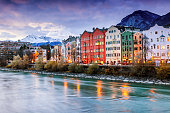 Beautiful cityscape. Innsbruck at night, Austria. Popular holiday destinations in Europe. The town surrounded by the Alps