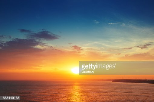 Beautiful cloudscape over the sea, sunset shot : Stock Photo