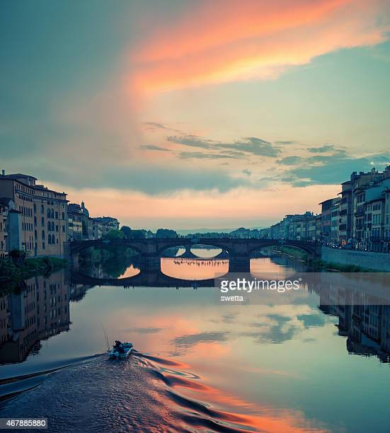Beautiful cloudy sunset over s bridge in Florence