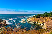 Beautiful coastline scenery on Pacific Coast Highway #1 at the US West Coast traveling south to Los Angeles, Big Sur Area, California - Picture made during a motorcycle road trip throughout the westen
