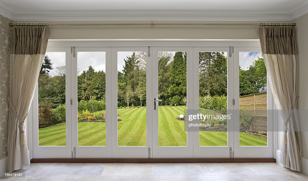 beautiful concertina doors with garden view : Stock Photo & Beautiful Concertina Doors With Garden View Stock Photo | Getty Images Pezcame.Com