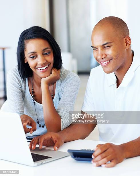 Beautiful couple calculating their expenses