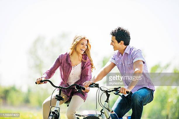Beautiful couple cycling in the park.