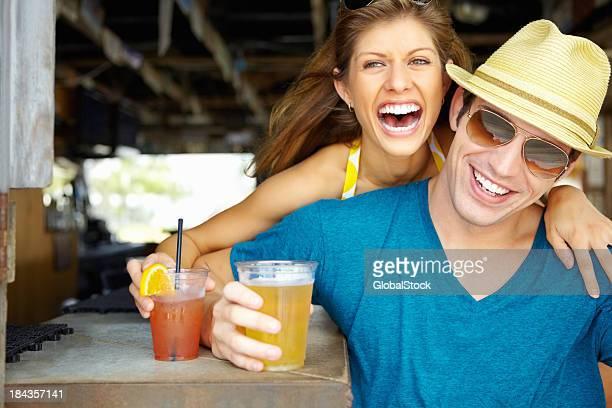 Beautiful couple enjoying a cocktail