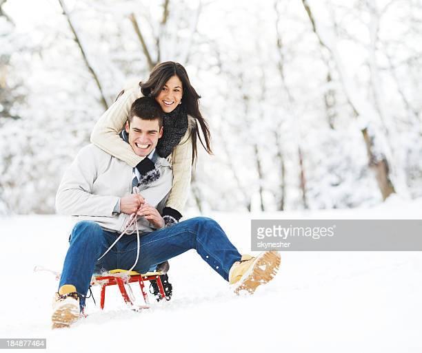 Beautiful couple enjoying in winter.