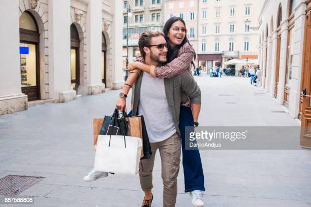 beautiful couple having fun in shopping