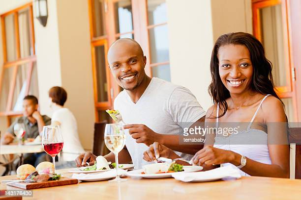 Beautiful Couple Having Meal in Outdoors Restaurant