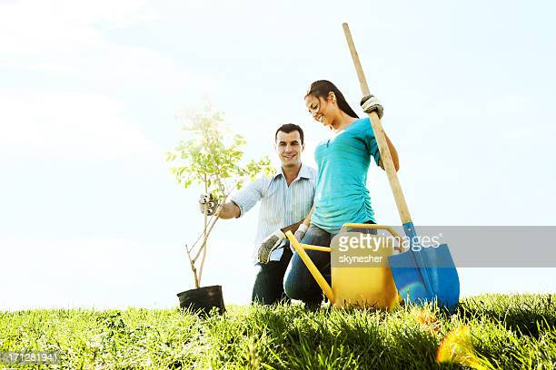 Beautiful couple planting a tree.