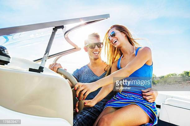 Beautiful couple riding a speedboat.