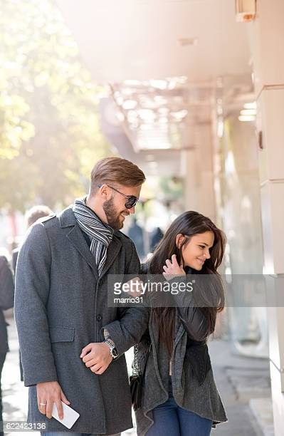 beautiful couple shopping together in the city