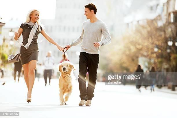 Beautiful couple walking the dog.