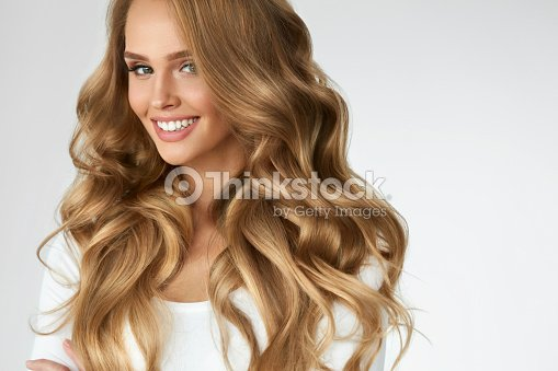 Beautiful Curly Hair. Girl With Wavy Long Hair Portrait. Volume : Stock Photo