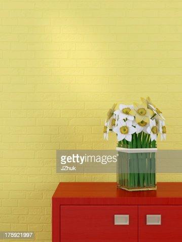 Beautiful daffodils in the interior : Stock Photo